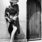 Woman checking her stockings/ photo 1939