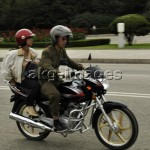 Couple on a motorbike on the Tongil Expressway, Pyongyang, 2009: © Alain Noguès / akg-images