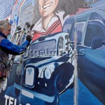 7FK-B3-0944-011558 - Irish muralist Danny Devenny works on a portrait of Bobby Sands as part of a mural on Divis Street, Belfast. -  © Bruno Barbier / akg-images