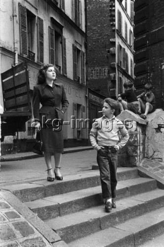 France, street scene, boy and prostitute