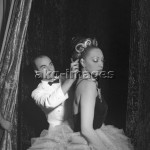 7IT-A1-0087002 Josephine Baker wearing a ballet dress, portrayed before a performance while Jean Clement adjusting her hair, Venice, 1949.  © akg-images / Archivio Cameraphoto Epoche