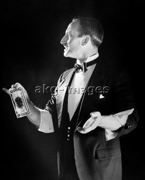 Magician in a tuxedo with sleeves rolled up, AKG2150174, © ClassicStock / akg-images / H. Armstrong Roberts
