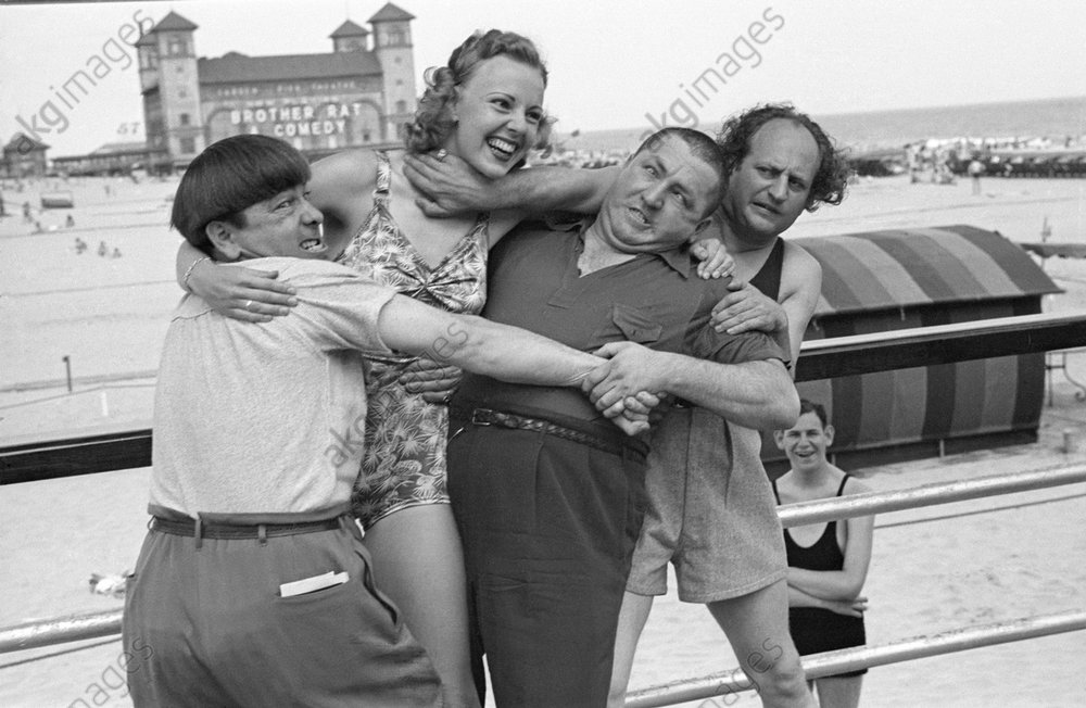 The Three Stooges and Barbara Bradford Mann clowning around on the Steel Pier, Atlantic City, New Jersey 1938 © akg-images / George Mann