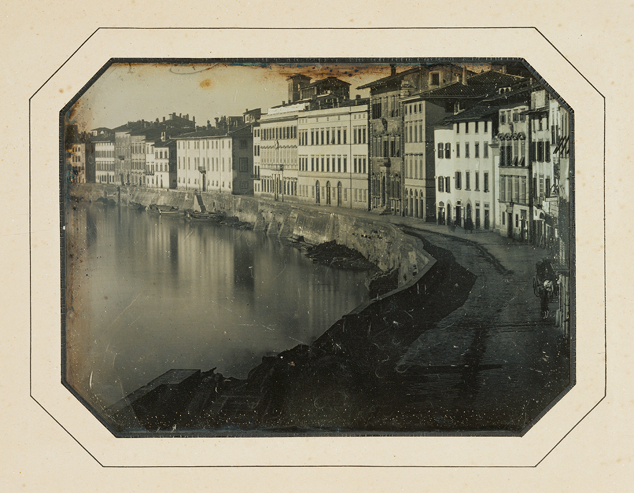 View of Pisa Along The Arno River; Unknown maker, French; May 1844; Daguerreotype; 1/2 plate, Image: 10.6 × 14.4 cm (4 3/16 × 5 11/16 in.), Object (whole): 17.3 × 21.6 cm (6 13/16 × 8 1/2 in.)