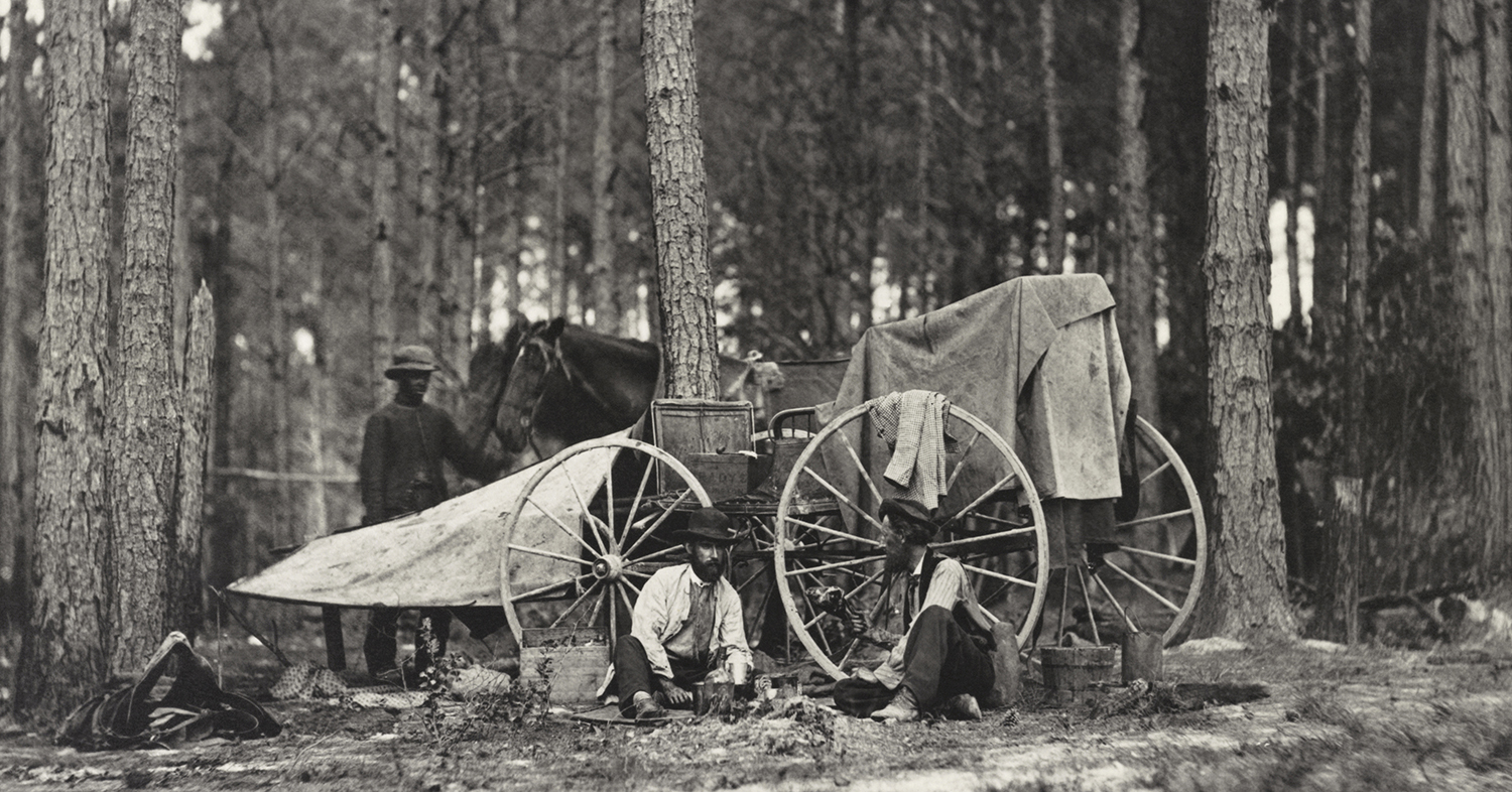 Petersburg, Virginia:  1864 Civil War photographer Mathew Brady seated, left, with his wagon and equipment used to photograph scenes on the battlefield